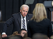 Vice President Joe Biden listens to a member of the audience as he takes questions after a speech at Iowa State University in Ames, Iowa on Thursday, March 1, 2012.