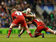 Picture by Andrew Tobin/Focus Images Ltd. 07710 761829. .27/12/11. George Robson (5) of Harlequins is tackled by Rhys Gill (1) of Saracens and George Kruis (5) of Saracens during the Aviva Premiership match between Harlequins and Saracens at Twickenham Stadium, London.