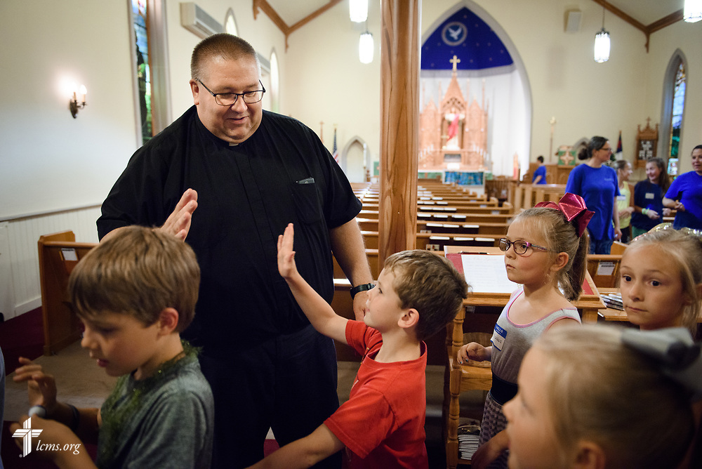 The Rev. David Daniels, pastor of Zion Lutheran Church, Ottawa, Ill., high-fives campers from Camp Courage VBS at the church on Thursday, July 13, 2017, in Ottawa. LCMS Communications/Erik M. Lunsford