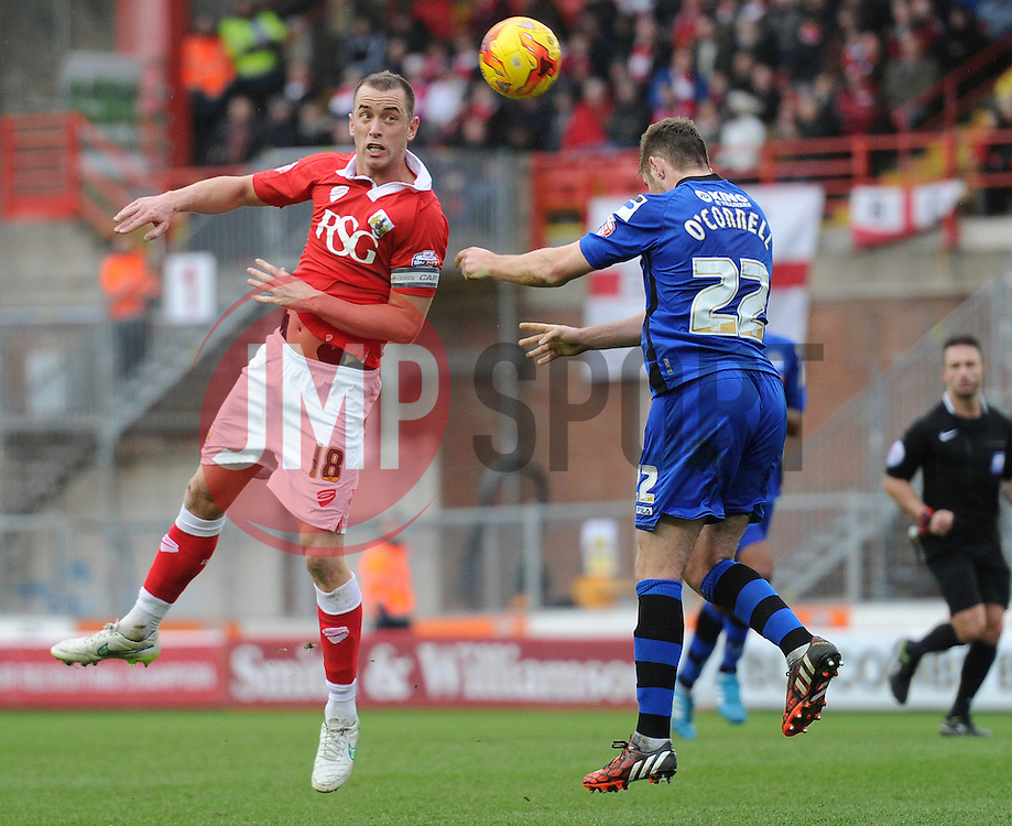 Bristol City's Aaron Wilbraham challenges for the header with Rochdale's Jack O'Connell - Photo mandatory by-line: Dougie Allward/JMP - Mobile: 07966 386802 - 28/02/2015 - SPORT - football - Bristol - Ashton Gate - Bristol City v Rochdale AFC - Sky Bet League One