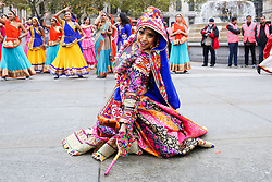 © Licensed to London News Pictures. 03/11/2019. London, UK. Dancers in colourful saris and costumes perform a traditional Indian dance in Trafalgar Square to celebrate Diwali - the festival of light. Hundreds of Hindus, Sikhs, Jains and people from all communities attend Diwali celebrations in London's Trafalgar Square. Diwali s celebrated each year with a free concert of traditional, religious and contemporary Asian music and dance. Photo credit: Dinendra Haria/LNP
