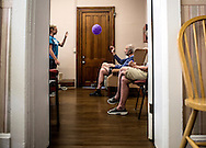 __________, a summer intern at the Carol Strawn Center tosses a balloon around with Tom Engeman and other clients before beginning their daily exercise routine. Every day Tom is dropped off at the Carol Strawn Center which offers adult daycare specifically for clients with Alzheimer's and Dementia.
