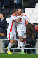 Dele Alli of MK Dons (right, #14) celebrates with Kyle McFadzean of MK Dons after scoring his sides first goal to make the scoreline 1-0 during the Sky Bet League 1 match between Milton Keynes Dons and Colchester United at stadium:mk, Milton Keynes<br /> Picture by Richard Blaxall/Focus Images Ltd +44 7853 364624<br /> 29/11/2014