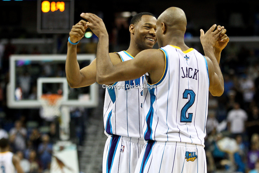 April 6, 2011; New Orleans, LA, USA; New Orleans Hornets shooting guard Willie Green (33) and point guard Jarrett Jack (2) celebrate in the final seconds of the fourth quarter against the Houston Rockets at the New Orleans Arena. The Hornets defeated the Rockets 101-93 and clinched a playoff spot with the victory.   Mandatory Credit: Derick E. Hingle-US PRESSWIRE