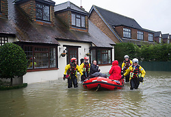 © London News Pictures. 11/02/2014. Wraysbury, UK.  Residents being rescued from home by members of the RSPCA in Wraysbury, Berkshire. The area has been hit hard by recent flooding from the nearby Thames River. Photo credit : Ben Cawthra/LNP