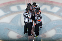 KELOWNA, CANADA - NOVEMBER 3:  Pat Smith and Nick Swaine, referees and Kris Hartley and Mike Langin, linesman, stand on the ice at the start of the game between the Prince George Cougars visit the Kelowna Rockets on November 3, 2012 at Prospera Place in Kelowna, British Columbia, Canada (Photo by Marissa Baecker/Shoot the Breeze) *** Local Caption ***