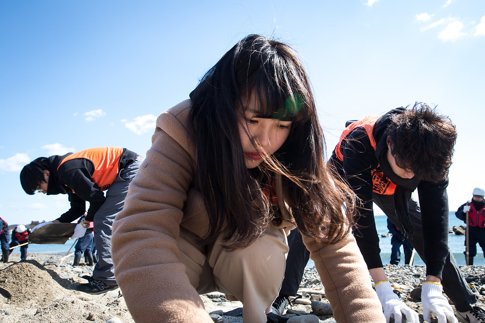 KESENNUMA, JAPAN - MARCH 11: A woman, volunteer search for the remains of people still unaccounted for in the wake of the March 11, 2011 earthquake and tsunami, on the coast of Kesennuma, Miyagi Prefecture on March 11, 2017. On this day Japan marks the sixth anniversary of a devastating earthquake and tsunami that hit on March 11, 2011 and left nearly 19,000 people dead or missing, turned coastal communities into wasteland and triggered a nuclear crisis. (Photo: Richard Atrero de Guzman/ANADOLU Agency)