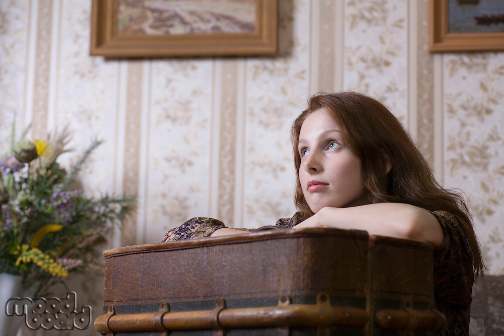 Young woman sits at desk in Russian apartment