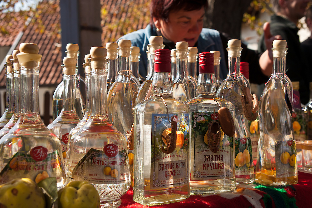 Rakija, or fruit brandy, for sale at the Harvest Festival, Topola, Serbia.