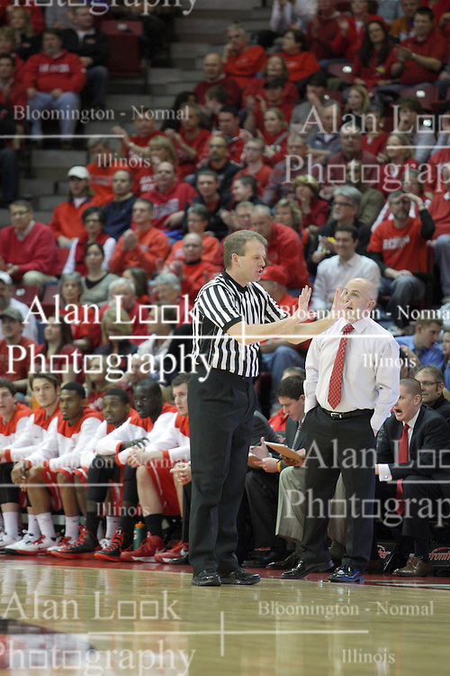 13 February 2013:  Referee Randy Heimerman calls a pushing foul during an NCAA Missouri Valley Conference mens basketball game where the Bradley Braves were defeated by Illinois State Redbirds 79-59 in Redbird Arena, Normal IL