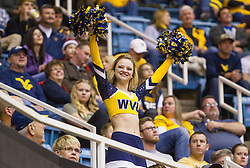 Dec 10, 2016; Morgantown, WV, USA; A West Virginia Mountaineers dance team member cheers during the first half at WVU Coliseum. Mandatory Credit: Ben Queen-USA TODAY Sports