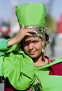 Girl wearing national costume in town of Mary in Turkmenistan