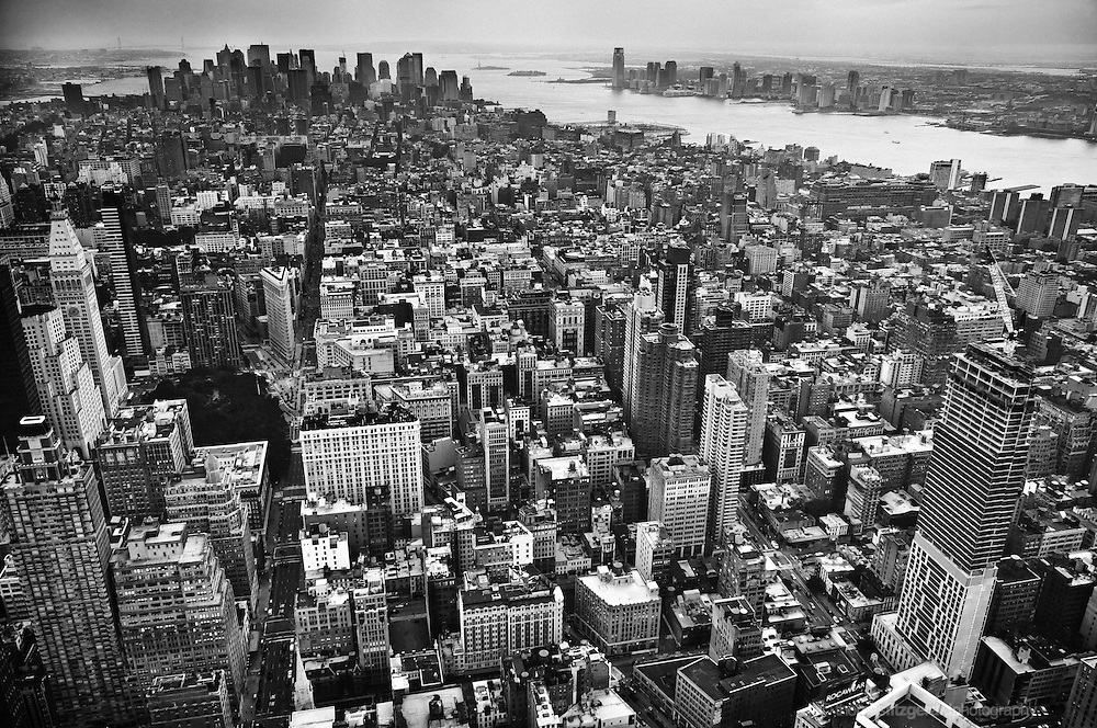 A Black and White view o the New York City Skyline looking south towards the financial district and the statue of Liberty