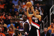 Apr 26, 2010; Phoenix, AZ, USA; Portland Trailblazers forward Nicolas Batum (88) fights for a loose ball with Phoenix Suns guard Jason Richardson (23) during the first quarter in game five in the first round of the 2010 NBA playoffs at the US Airways Arena.  Mandatory Credit: Jennifer Stewart-US PRESSWIRE
