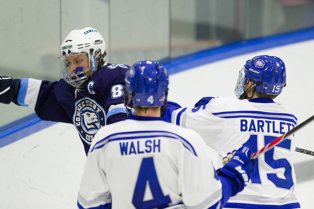 Jack Bartlett and Alex Walsh, of Colby College, in a NCAA Division III hockey game against Connecticut College on December 7, 2013 in Waterville, ME. (Dustin Satloff/Colby College Athletics)
