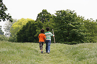 Two brothers (7-9) walking in field