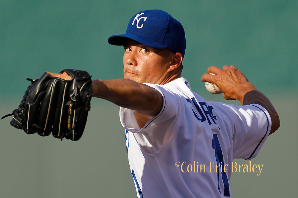 Kansas City Royals pitcher Jeremy Guthrie warms up before the first inning of a baseball game against the Boston Red Sox at Kauffman Stadium in Kansas City, Mo., Saturday, Aug. 10, 2013. (AP Photo/Colin E. Braley)