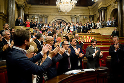 September 6, 2017 - Barcelona, Catalonia, Spain - Pro-indepndentist members of the Catalonia Parliament celebrate at the end of the parliamentary session. The Catalan Parliament has passed a law to call a referendum of independence the next first of October. The unionist forces of Catalonia and the Spanish government are frontally opposed to the referendum and consider it illegal. (Credit Image: © Jordi Boixareu via ZUMA Wire)