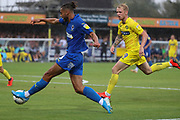 AFC Wimbledon defender Nesta Guinness-Walker (18) crossing the ball in box during the EFL Sky Bet League 1 match between AFC Wimbledon and Wycombe Wanderers at the Cherry Red Records Stadium, Kingston, England on 31 August 2019.