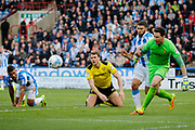 Burton Albion goalkeeper Jon McLaughlin (1) makes a save from Huddersfield Town forward Elias Kachunga (9) as Burton Albion defender Ben Turner (6) watches on during the EFL Sky Bet Championship match between Huddersfield Town and Burton Albion at the John Smiths Stadium, Huddersfield, England on 1 April 2017. Photo by Richard Holmes.