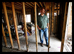May 5th, 2006. New Orleans, Louisiana. Saint Bernard Parish, east of the city. Councilman Craig Taffaro stands in the ruins of his home in Earl Drive. Taffaro witnessed the destruction of hurricane Katrina first hand from the council offices and was immediately on scene after the storm to help his devastated residents and parish.
