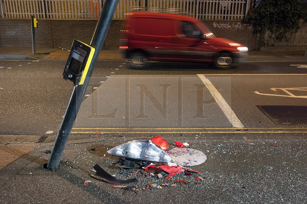 © licensed to London News Pictures.  07/01/2013. London, UK. Broken car parts and damaged pedestrian crossing buttons on Ilderton Road, New Cross, London at the scene where a 13-year-old girl  died after a crash involving a car being pursued by police. The 13 year-old  was in the back of a Volkswagen Golf when it was  hit by a car being pursued by a marked police car. Photo credit: Tolga Akmen/LNP