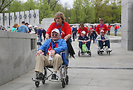 Korea War Veteran Richard Marvets of Tripoli is pushed around by Sue Gibson of Waterloo during the Sullivan-Hartogh-Davis Post 730 Honor Flight  at the National World War II Memorial in Washington, DC on Tuesday, April 16, 2013. About 90 veterans were on the trip. After their visit to the National World War II Memorial they would take a bus tour of Washington, DC followed by a visit to the Korean War Veterans Memorial.