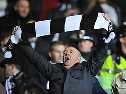Swansea city fan sings during the game. - Photo mandatory by-line: Alex James/JMP - Tel: Mobile: 07966 386802 08/02/2014 - SPORT - FOOTBALL - Swansea - Liberty Stadium - Swansea City v Cardiff City - Barclays Premier League