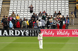 Tourists go on the Lords cricket ground tour while sub fielder Middlesex's Ryan Higgins fields in the deep - Photo mandatory by-line: Robbie Stephenson/JMP - Mobile: 07966 386802 - 03/05/2015 - SPORT - Football - London - Lords  - Middlesex CCC v Durham CCC - County Championship Division One