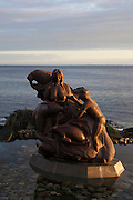 """A statue at the old harbour in Nuuk, Greenland of Arnakuagsak , or Sassuma arnaa, also known as Sedna, the goddess of the sea in Inuit culture. By artist  Christian """"Nuunu"""" Rosing."""