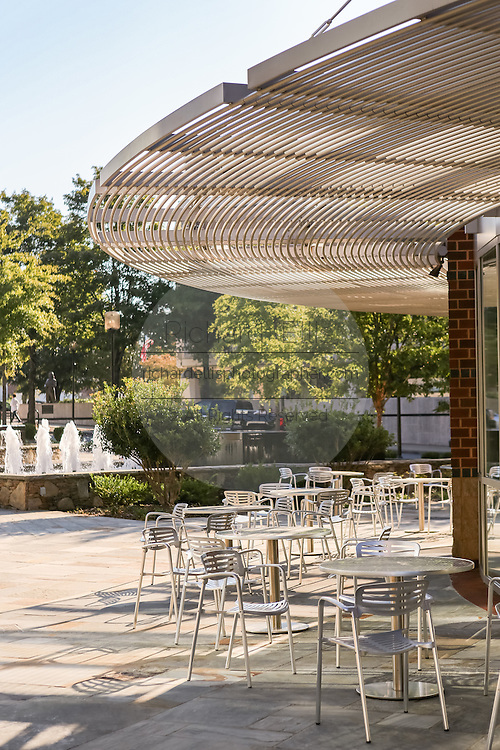 Outdoor cafe tables along Main Street at the Peace Center in downtown Greenville, South Carolina.