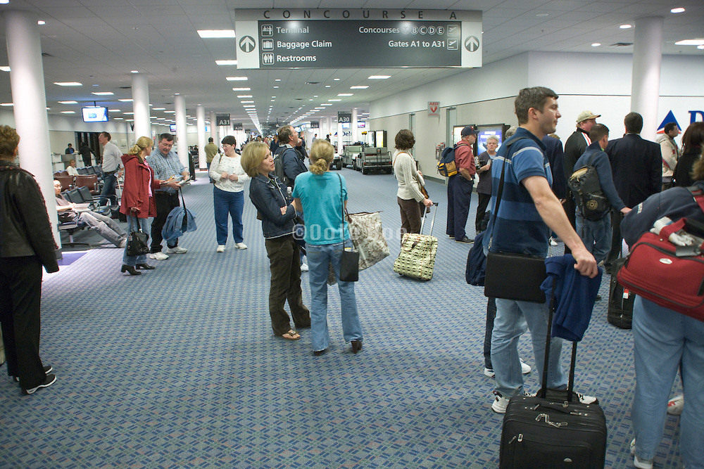 passengers waiting to board an airplane