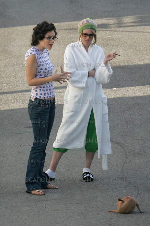 LOS ANGELES, CALIFORNIA - Wednesday 8th August 2007. NON EXCLUSIVE: Katherine McPhee with her pet dog on the set of 'House Bunny'. Photograph: Buchan/Ford/On location News. Sales: Eric Ford 1/818-613-3955 info@OnLocationNews.com.