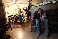 Senior Nathan Powell (right) keeps an eye on his friends 5-month-old nephew, Ayden Moralez, Friday, Oct. 19, 2012 as he hangs out after school on Friday at Javier Moralez's home in Premont. Without football, Nathan said he usually goes home and naps after school or spends times with friends. The district continues to try to meet the state's amended list of demands to remain open. Many students have left the district, some because of educational concerns, and others because there is no football. Even with the uncertainty and lack of fall sports, Nathan said he didn't want to leave Premont.