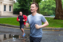© Licensed to London News Pictures. 25/06/2019. London, UK. Foreign Secretary Jeremy Hunt, who is running to be the next Leader of the Conservative Party and prime minister, returns to his London home after a run.Photo credit: Rob Pinney/LNP