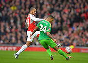 Arsenal Forward Theo Walcott and Sunderland Defender DeAndre Yedlin during the The FA Cup match between Arsenal and Sunderland at the Emirates Stadium, London, England on 9 January 2016. Photo by Adam Rivers.