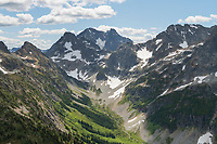 Upper Fisher Creek basin.Fisher Peak, Black Peak and Mount Arriva are in the distance. North Cascades National Park Washington