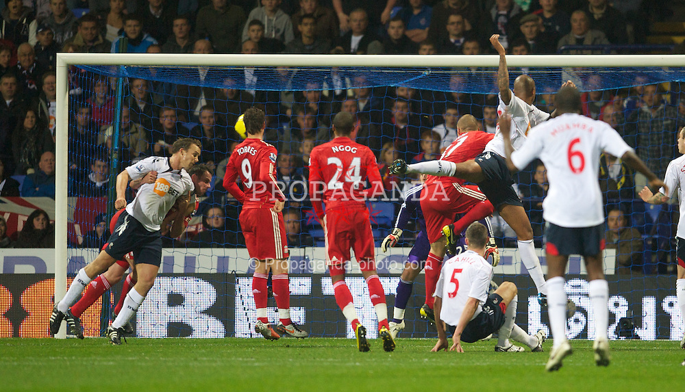 BOLTON, ENGLAND - Sunday, October 31, 2010: Liverpool's Jamie Carragher pulls down Bolton Wanderers' Kevin Davies but no penalty is given during the Premiership match at the Reebok Stadium. (Pic by: David Rawcliffe/Propaganda)