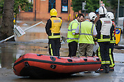 Emergency services deal with closed businesses and deep water following a burst water main closed the otherwise busy junction of Half Moon Lane and Dulwich Road in the south London area of Herne Hill. At about 5am, emergency crews were called when water inundated local homes and businesses, forcing residents to evacuate their properties and leave before electricity supplies were shut down.