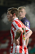 Jack Dunn during the Sky Bet League 2 match between Cheltenham Town and Morecambe at Whaddon Road, Cheltenham, England on 16 January 2015. Photo by Alan Franklin.