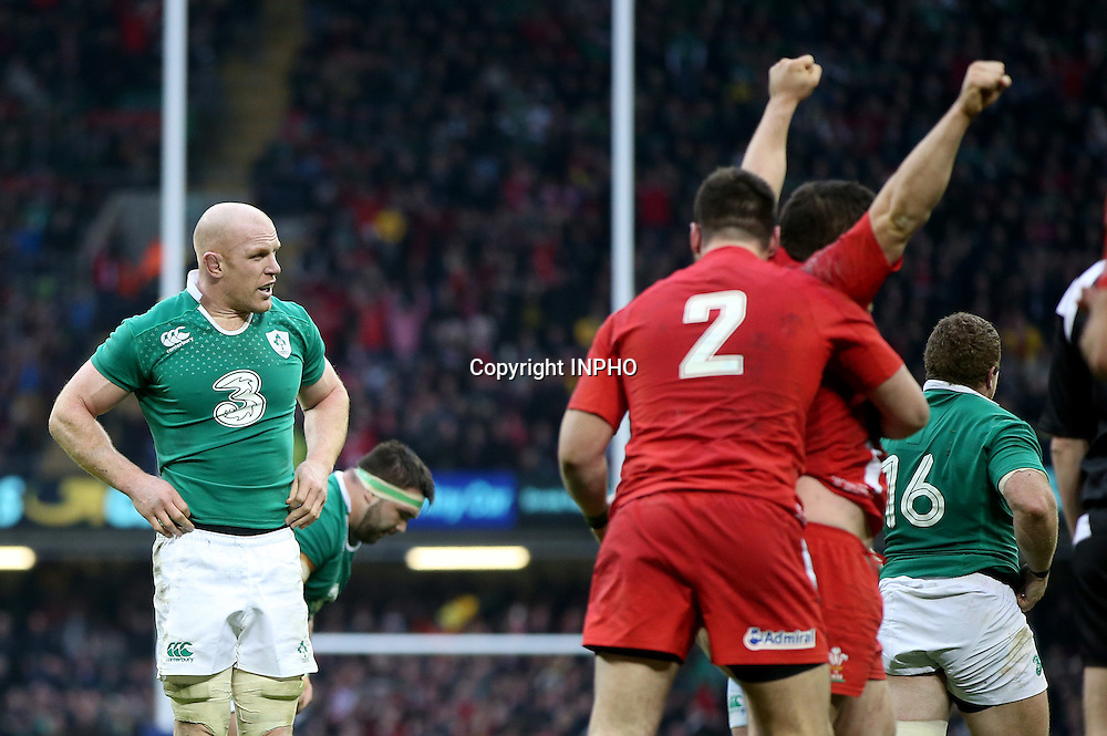 RBS 6 Nations Championship, Millennium Stadium, Cardiff, Wales 14/3/2015<br /> Wales vs Ireland <br /> Ireland's Paul O'Connell dejected at the final whistle as Wales players celebrate <br /> Mandatory Credit &copy;INPHO/Dan Sheridan