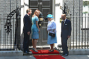 © Licensed to London News Pictures. 24/07/2012. Westminster, UK HRH Queen Elizabeth II and the Duke of Edinburgh on the steps of number 10.  The British Prime Minister David Cameron hosts a lunch today 24th July 2012 at Downing Street for HM The Queen and the Duke of Edinburgh with the Deputy Prime Minister and past Prime Ministers, Sir John Major, Tony Blair and Gordon Brown. Photo credit : Stephen Simpson/LNP