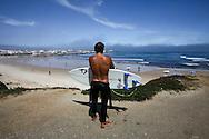 Surfer at Baleal Beach, Peniche, Portugal. PHOTO PAULO CUNHA/4SEE