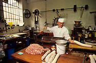 """France. Lyon . A traditional pork butcher, Mr jean Vautaret, preparing, """"rosette"""", a salami type sausage, speciality of Lyon Charcuterie à l'ancienne, Mr Jean Vautaretprepare la rosette à l'ancienne.  R00069 9L930922 P0000221"""