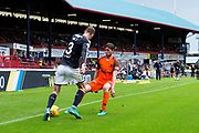 Dundee defender Kevin Holt (#3) takes on Dundee United midfielder Sam Stanton (#12) during the Betfred Scottish Cup group stage match between Dundee and Dundee United at Dens Park, Dundee, Scotland on 29 July 2017. Photo by Craig Doyle.