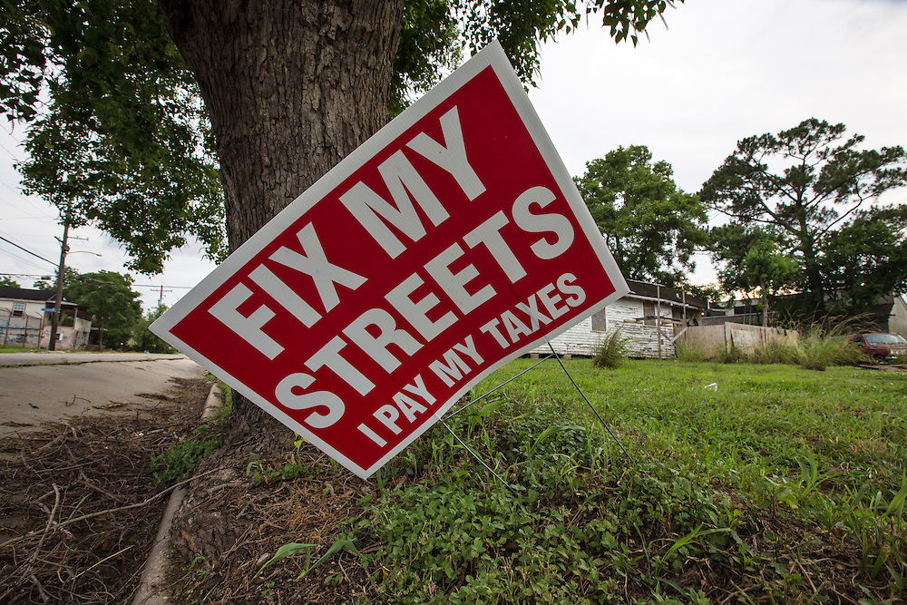 May 25, 2015, New Orleans, LA, 'Fix our streets' sign, next to a blighted home  in the  9th Ward almost ten years after Hurricane Katrina flooded the area. The roads in New Orleans in many areas remain a mess.