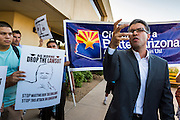 17 OCTOBER 2013 - PHOENIX, AZ: RANDY PARRAZ, a civil rights activist in Arizona, speaks out against Arizona Attorney General Tom Horne in front of the offices of the Arizona Attorney General Thursday. About 100 people came to the office of Arizona Attorney General Tom Horne to protest the decision by Horne to sue community colleges in Maricopa County that charge DREAM Act students who are residents of Arizona out of state tuition rather than in state resident tuition. Nearly 10 people were arrested in a planned civil disobedience during the protest.     PHOTO BY JACK KURTZ