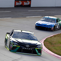 JJ Yeley (23) races through turn three to practice  for the First Data 500 at Martinsville Speedway in Martinsville, Virginia.