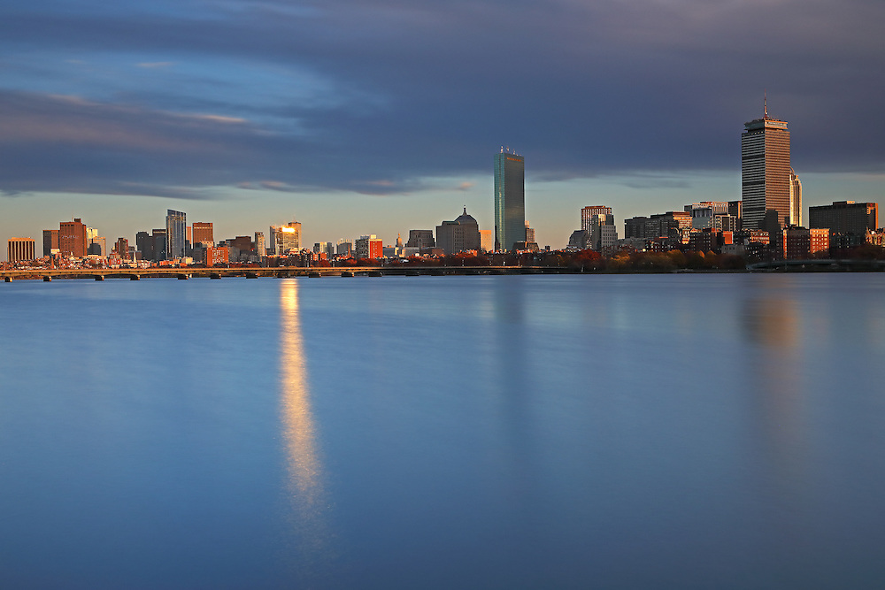 Golden Hour Boston photos featuring familiar landmarks along the Charles River, such as the Prudential Center and 200 Clarendon better known as the John Hancock Tower. This Boston skyline photo at late afternoon is available as museum quality photography prints, canvas prints, acrylic prints or metal prints. Fine art prints may be framed and matted to the individual liking and decorating needs:<br />