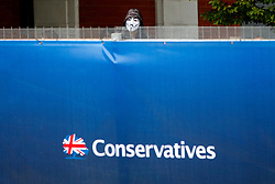 © Licensed to London News Pictures. 06/10/2015. Manchester, UK. Anti-austerity protesters demonstrating over the fence outside Conservative Party Conference at Manchester Central convention centre on Tuesday, 6 October 2015. Photo credit: Tolga Akmen/LNP